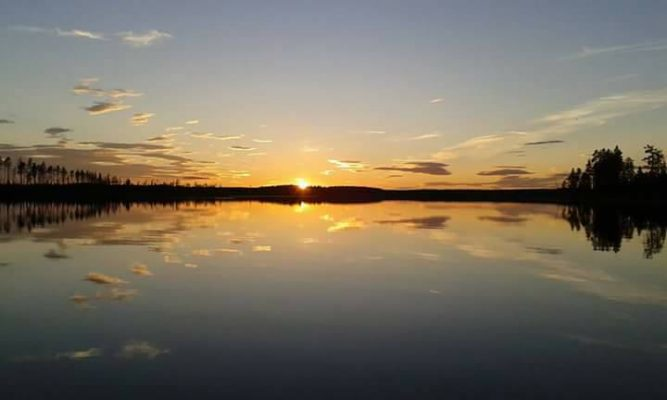 Solnedgång i StorUgsi i Älvdalen