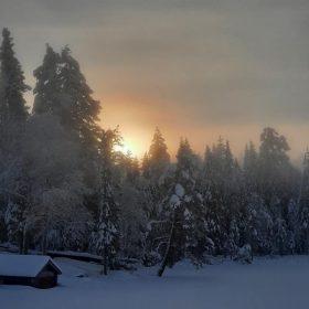 Solnedgång över Rämmasjön på vintern